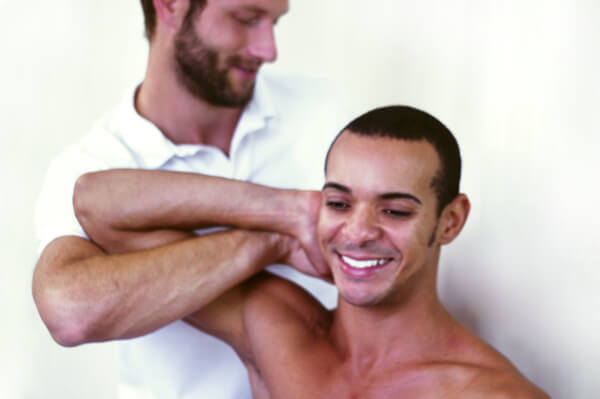 Osteopath Dr Christoph Datler providing osteopathic treatment for shoulder and neck pain